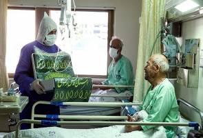 عیادت خادمان امام رضا (ع) از بیماران کرونایی بیمارستان میلاد